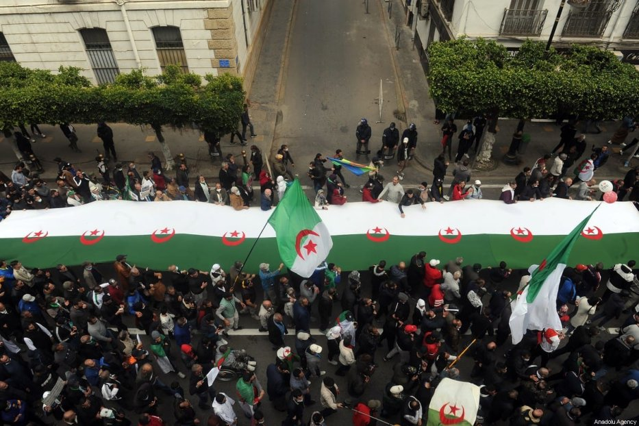 Thousands of people gather to stage a demonstration as part of the second anniversary of Hirak movement, in Algiers, Algeria on 19 March 2021. [Mousaab Rouibi - Anadolu Agency]