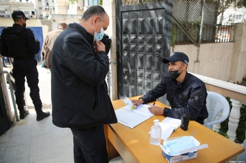 Officials are seen at Central Election Commission building after Palestinian authorities on Saturday opened registration for the legislative elections, scheduled for May 22, in Gaza City, Gaza on March 20, 2021 [Mustafa Hassona/Anadolu Agency]