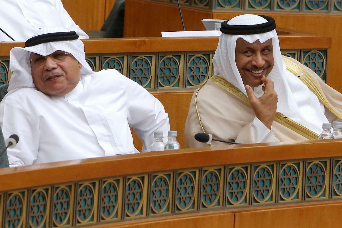 Kuwaiti Prime Minister Sheikh Jaber al-Mubarak al-Sabah (R) and Kuwaiti Interior Minister Sheikh Khaled al-Jarrah smile, during a parliament session at Kuwait's National Assembly, in Kuwait City on 3 July 2019. [YASSER AL-ZAYYAT/AFP via Getty Images]