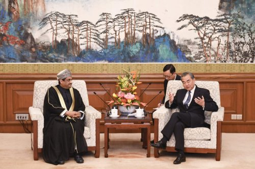 Chinese Foreign Minister Wang Yi (R) speaks during a meeting with Oman's Ambassador to China, Abdullah Saleh Al Saadi (L) at the Diaoyutai State Guesthouse in Beijing on October 30, 2019 [MADOKA IKEGAMI/POOL/AFP via Getty Images]