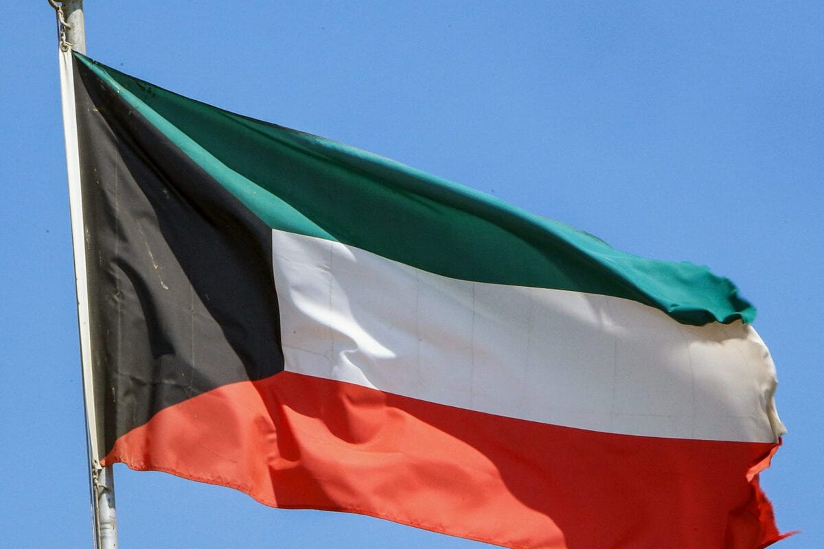 This picture taken on September 20, 2020 shows a Kuwaiti national flag flying from a mast in Kuwait City [YASSER AL-ZAYYAT/AFP via Getty Images]