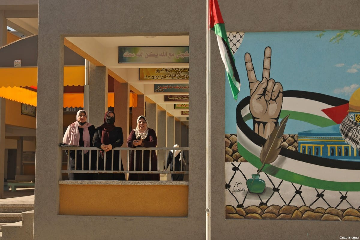 Palestinian teachers are pictured near the opening of the first Voter Information and Registration Centre in Gaza City on February 10, 2021. [MOHAMMED ABED/AFP via Getty Images]