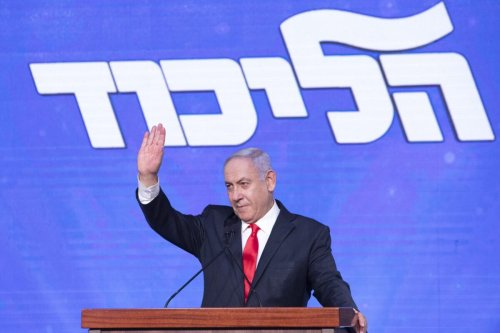 Benjamin Netanyahu, Israel's prime minister and the leader of the Likud party, waves to his supporters on stage during a party event in Jerusalem, Israel, on Wednesday, March 24, 2021 [Kobi Wolf/Bloomberg via Getty Image]