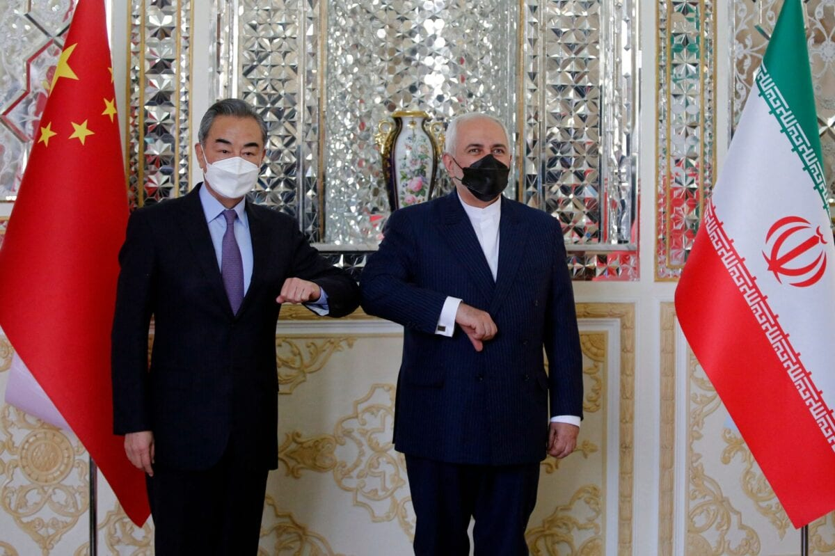 Iranian Foreign Minister Mohammad Javad Zarif (R) greets his Chinese counterpart Wang Yi, in the capital Tehran, on March 27, 2021 [AFP via Getty Images]