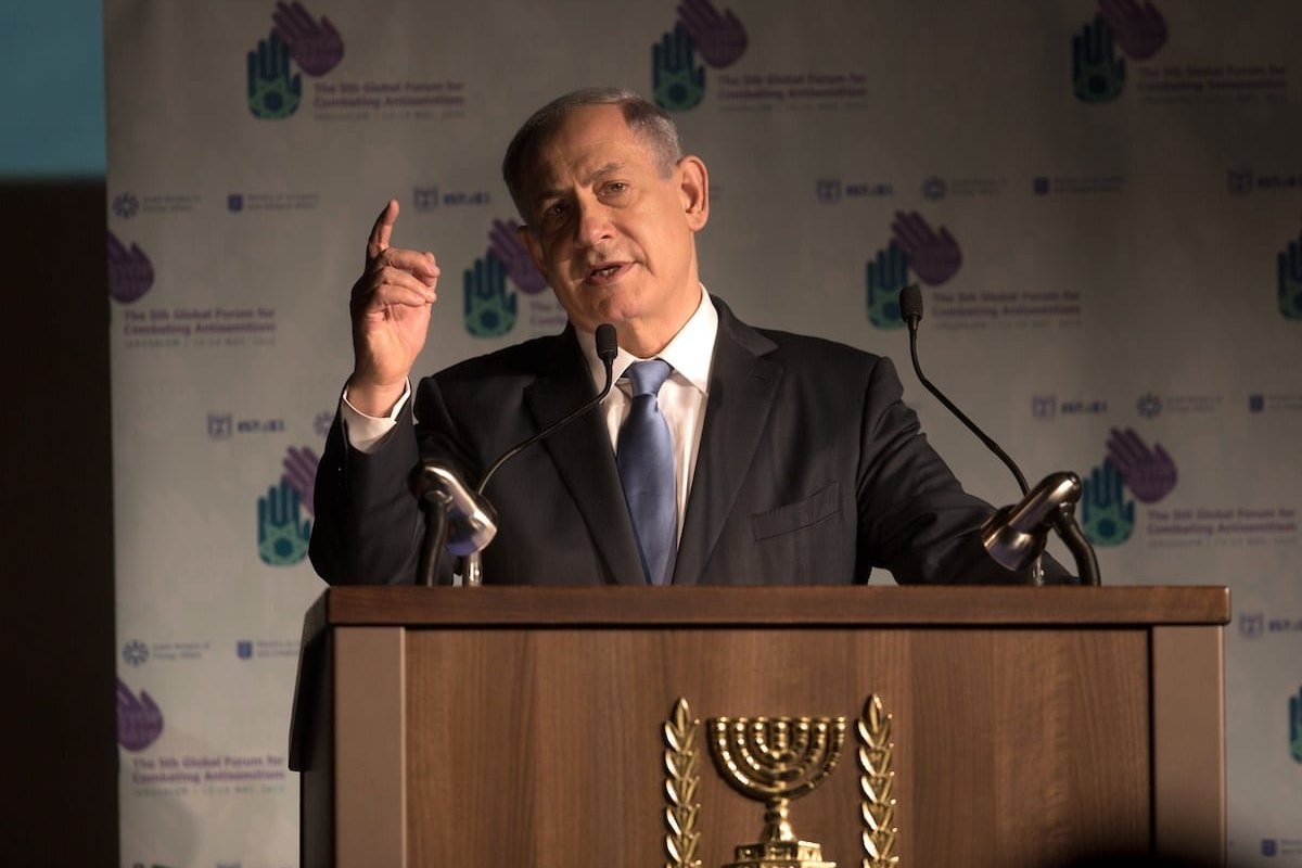 Israeli Prime Minister Benjamin Netanyahu delivers a speech at the 5th Global Forum for Combating Anti-Semitism conference at the International Convention Center in Jerusalem, on 12 May 2015. [MENAHEM KAHANA/AFP via Getty Images]