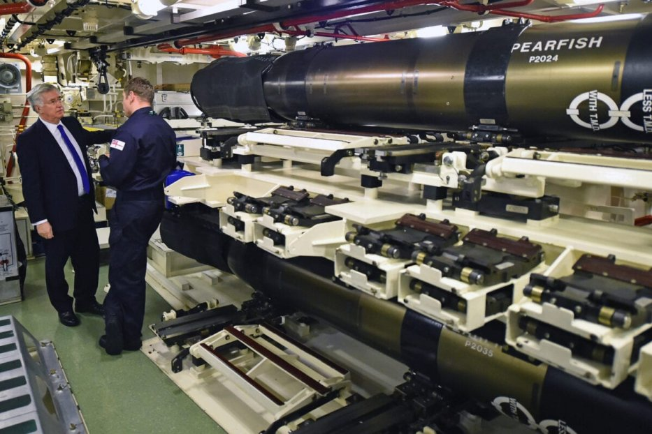 RHU, SCOTLAND - JANUARY 21: Defence Secretary Michael Fallon, in the weapons storage compartment onboard HMS Vigilant at Her Majesty's Naval Base, Clyde on January 21, 2016 in Rhu, Scotland. HMS Vigilant is one of the UK's fleet of four Vanguard class nuclear-powered ballistic missile submarines carrying the Trident nuclear missile system. A decision on when to hold a key Westminster vote on renewing Trident submarine class is yet to be decided senior Whitehall sources have admitted. (Photo by Jeff J Mitchell/Getty Images)