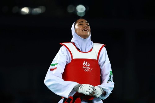 Kimia Alizadeh Zenoorin of Iran cries during the Women's Taekwondo 57kg quarter finals at the Carioca Arena on Day 13 of the 2016 Rio Olympic Games on August 18, 2016 in Rio de Janeiro, Brazil [Amin Mohammad Jamali/Getty Images]
