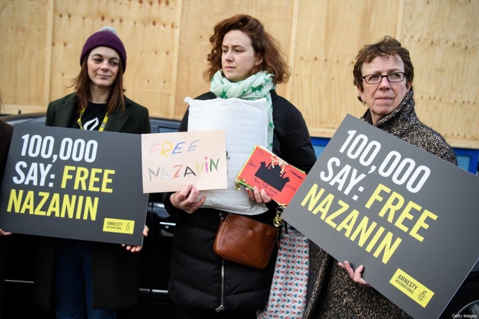 LONDON, ENGLAND - FEBRUARY 21: Supporters hold a collection of letters and posters calling for the release of jailed UK-Iranian woman Nazanin Zaghari-Ratcliffe before delivering them to the Iranian Embassy on February 21, 2018 in London, England. Her husband, Richard Ratcliffe had spoken to the press before attempting to deliver the letters ahead of a visit by Abbas Araghchi, Deputy for Legal and International Affairs in Iran's Foreign Ministry. (Photo by Leon Neal/Getty Images)