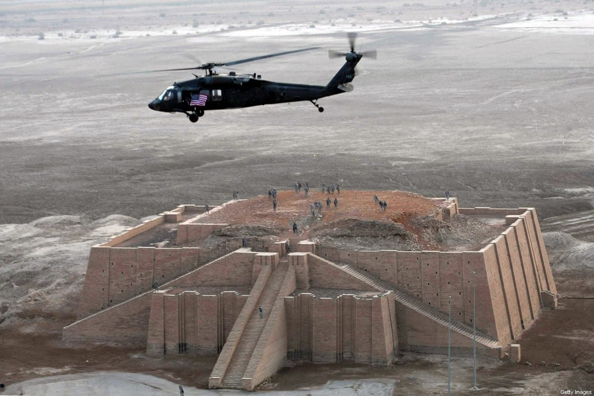 A US army helicopter flies over the stepped Ziggurat temple, a three-tiered edifice dating back to 2113 BC, in the ancient city of Ur in southern Iraq on February 4, 2010. he buried antiquities of Ur, Biblical birthplace of Abraham and one of the cradles of civilisation, could one day outshine those of ancient Egypt, archaeologists and workers on the site believe. AFP PHOTO/ESSAM AL-SUDANI (Photo credit should read ESSAM AL-SUDANI/AFP via Getty Images)