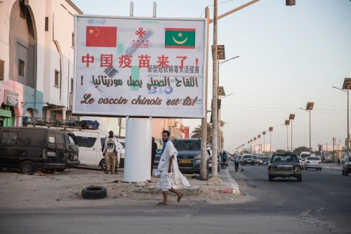 A sign board reading 'The Chinese Vaccine is here!' is pictured in Nouakchott, Mauritania on 22 March 2021 [MED LEMIN RAJEL/AFP/Getty Images]