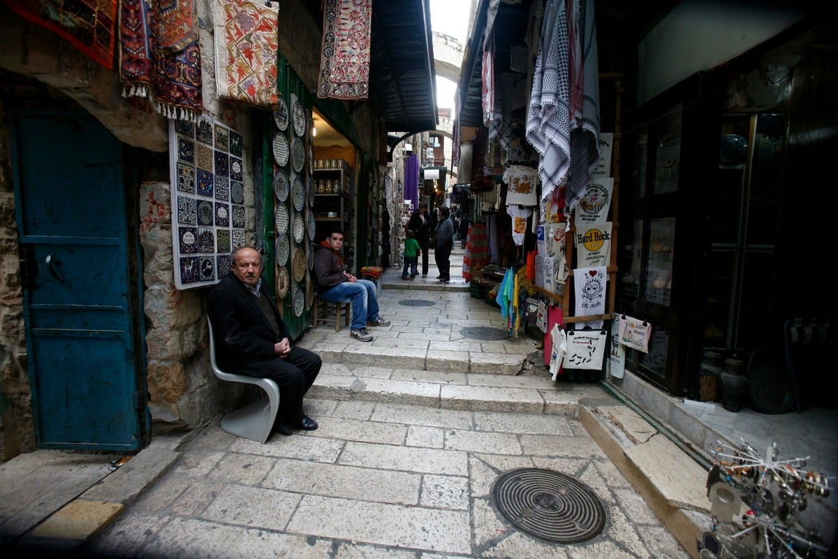 Palestinians shop at the market in Jerusalem's Old City on 29 December 2019 [Mahfouz Abu Turk/ApaImages]