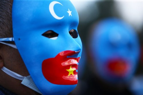 People gather in Turkey to stage a protest against China's policies and human rights violations towards Uyghurs on 25 March 2021 [Eren Bozkurt/Anadolu Agency]