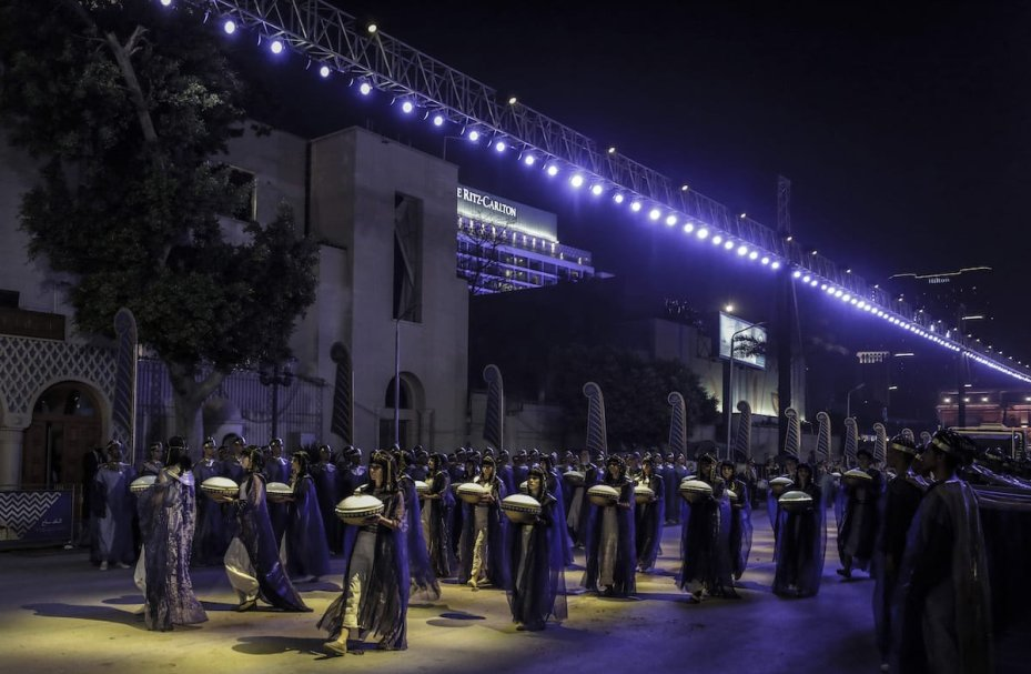 CAIRO, EGYPT - APRIL 03: People wearing ancient Egyptian costumes take part in the ceremony as specially designed vehicles transport 22 mummies in a convoy from the Egyptian Museum to the new National Museum of Egyptian Civilization, during the Pharaohs' Golden Parade in Cairo, Egypt on April 03, 2021. ( Stringer - Anadolu Agency )