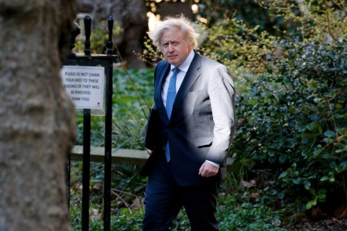 British Prime Minister Boris Johnson returns to 10 Downing Street from hosting a coronavirus press conference in the briefing room at 9 Downing Street London, United Kingdom on 5 April 2021. [David Cliff - Anadolu Agency]