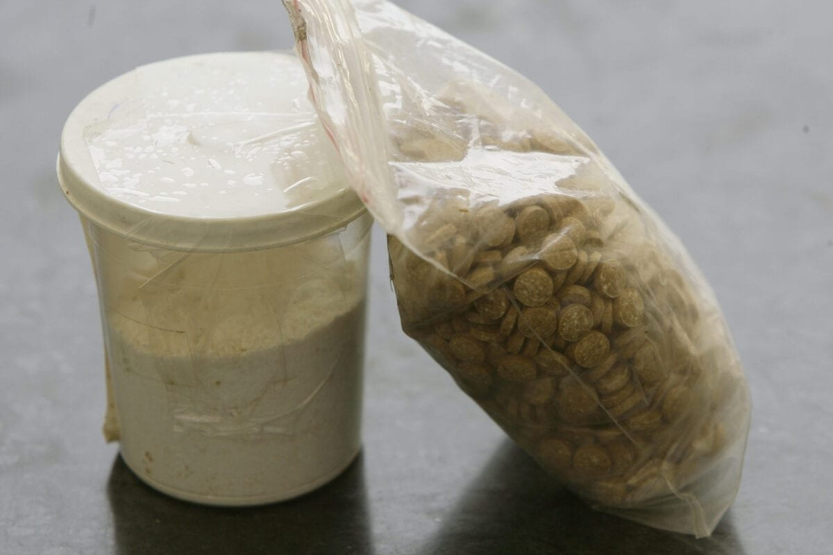Captagon pills are displayed along with a cup of cocaine at an office of the Lebanese Internal Security Forces in Beirut on June 11, 2010 [JOSEPH EID/AFP via Getty Images]