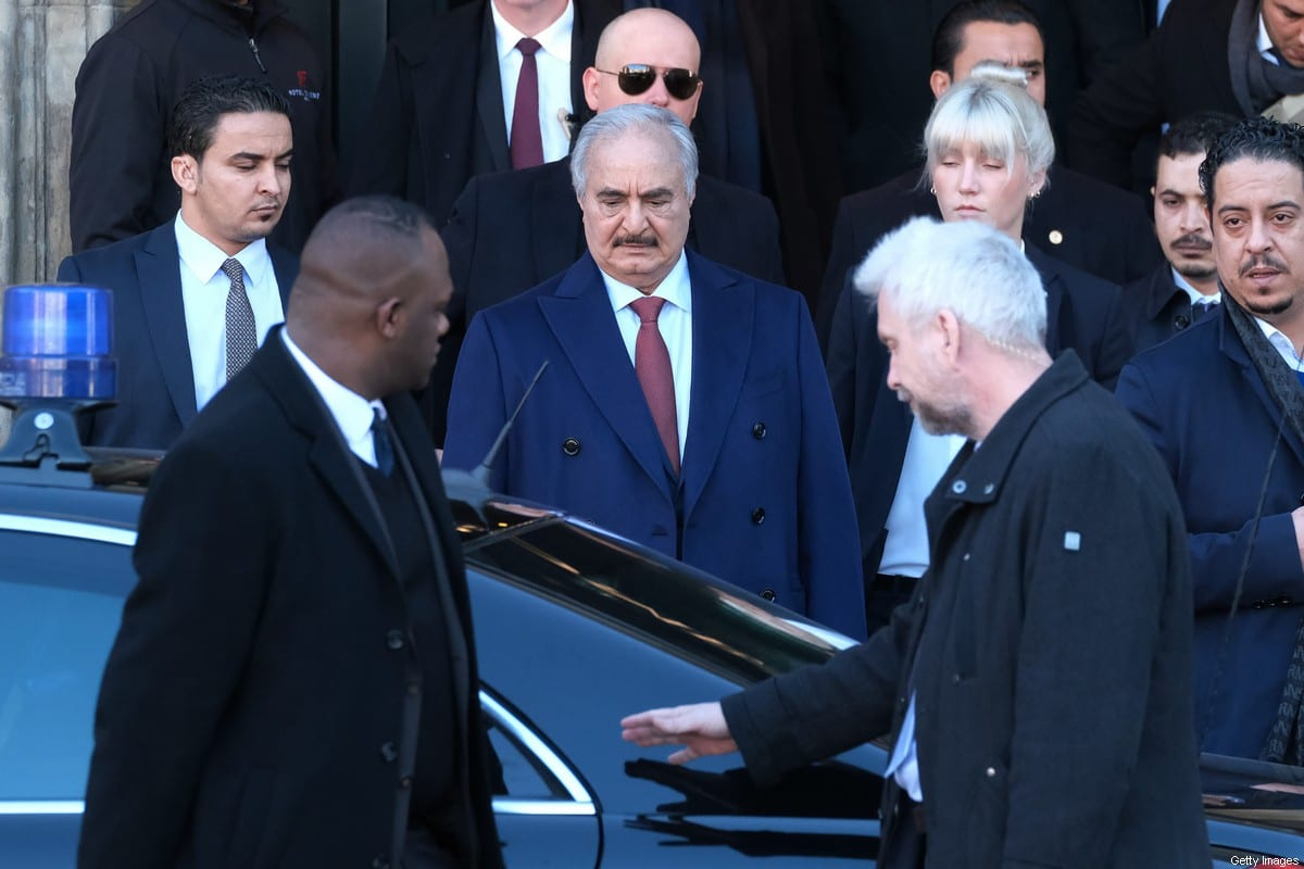 Libyan Field Marshall Khalifa Haftar (C) steps into a limousine as he departs from the Hotel de Rome on January 21, 2020 in Berlin, Germany. [Sean Gallup/Getty Images]