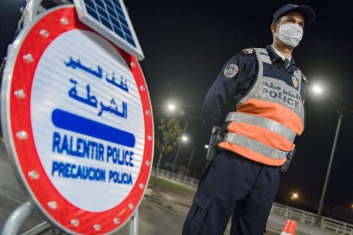 A Moroccan police officer mans a checkpoint during night curfew in Rabat, early on May 2, 2020 [FADEL SENNA/AFP via Getty Images]