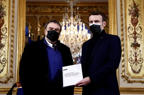 French President Emmanuel Macron (R) poses with French historian Benjamin Stora for the delivery of a report on the colonisation and the Algerian War at the Elysee Palace in Paris on January 20, 2021 [CHRISTIAN HARTMANN/POOL/AFP via Getty Images]
