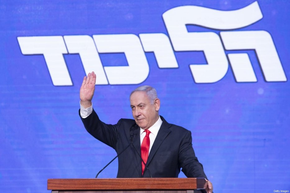 Benjamin Netanyahu, Israel's prime minister and the leader of the Likud party, waves to his supporters on stage during a party event in Jerusalem, Israel, on Wednesday, March 24, 2021 [Kobi Wolf/Bloomberg via Getty Images]