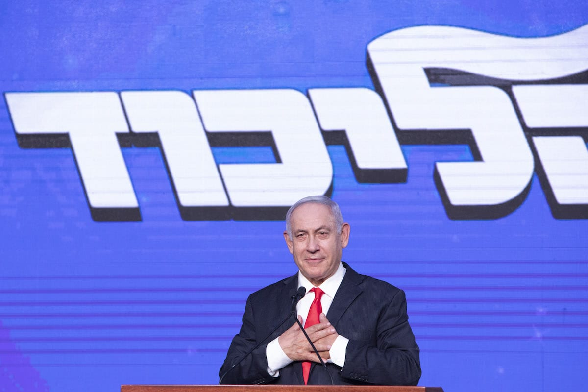 Benjamin Netanyahu, Israel's prime minister and the leader of the Likud party, gestures as he speaks during a party event in Jerusalem, Israel, on Wednesday, 24 March 2021. [Kobi Wolf/Bloomberg via Getty Images]