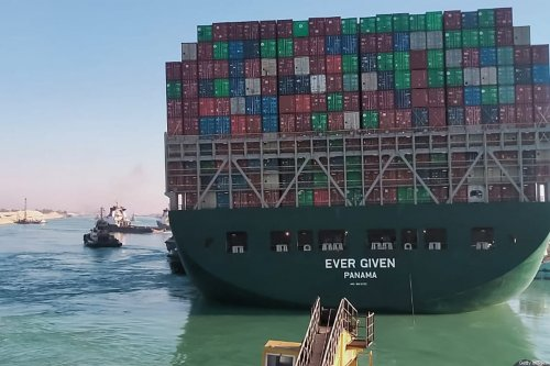 This picture taken on March 29, 2021 from a nearby tugboat in the Suez Canal shows a view of the Panama-flagged MV 'Ever Given' [AFP via Getty Images]