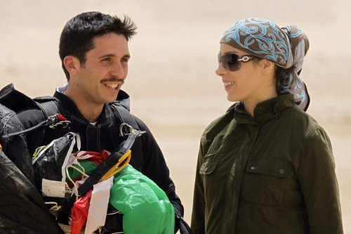 "Jordanian Prince Hamzah bin al-Hussein (L), president of the Royal Aero Sports Club of Jordan, and his wife Princess Basma attend a media event to announce the launch of ""Skydive Jordan"", in the Wadi Rum desert on April 19, 2011. Skydive Jordan will be held June 8th till June 30th in Wadi Rum. AFP PHOTO/KHALIL MAZRAAWI (Photo by KHALIL MAZRAAWI / AFP) (Photo by KHALIL MAZRAAWI/AFP via Getty Images)"