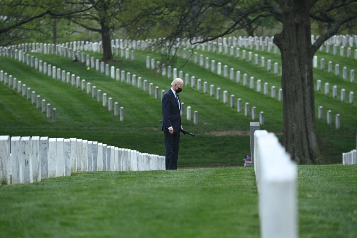 US President Joe Biden walks through Arlington National cemetary to honor fallen veterans of the Afghan conflict in Arlington, Virginia on April 14, 2021 [BRENDAN SMIALOWSKI/AFP via Getty Images]