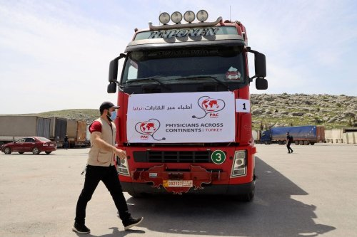 A truck carrying the first batch of AstraZeneca COVID-19 vaccines arrives at Bab al-Hawa border crossing between Syria and Turkey in Syria's rebel-held northwestern Idlib on 21 April 2021. [MOHAMMED AL-RIFAI/AFP via Getty Images]