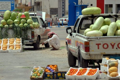 A Saudi street vendor waits for customers to buy watermelons and melons from the back of his pick-up truck in Riyadh on June 5, 2012 [FAYEZ NURELDINE/AFP/GettyImages]