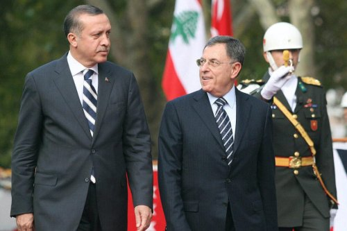 Lebanon's Prime Minister Fouad Siniora (R) and his Turkish counterpart Tayyip Erdogan review a guard of honour during a welcoming ceremony in Ankara on 3 November 2008. [ADEM ALTAN/AFP via Getty Images]