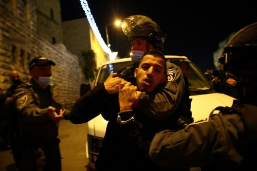 JERUSALEM - APRIL 15: Israeli forces intervene in Palestinians as they gather around the Damascus Gate after performing Tarawih prayer in Al-Aqsa Compound, in Eastern Jerusalem on April 15, 2021. Israeli forces took into custody some of Palestinians during the intervention. ( Mostafa Alkharouf - Anadolu Agency )