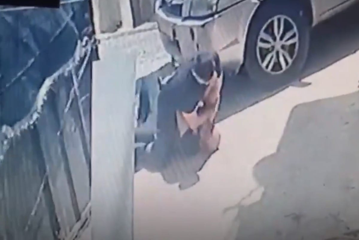 Screengrab of the attack by private Israel security guard on a disabled Palestinian man [Silwanic1/Twitter]