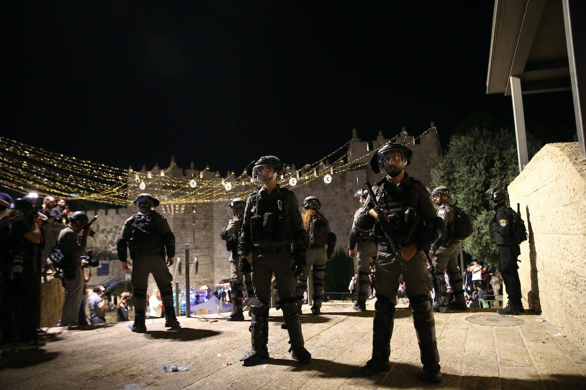 Israeli forces intervene in Palestinians as Palestinians stage a demonstration against Israeli violations towards Palestinians at Damascus Gate of Masjid al-Aqsa Compound in East Jerusalem on May 10, 2021 [Mostafa Alkharouf/Anadolu Agency]