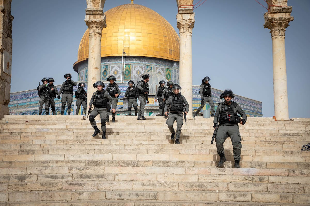 Israeli police use tear gas, rubber bullets and stun grenades to disperse Palestinians who were standing at Al-Aqsa Mosque's gates to prevent raids by extremist Jews, in East Jerusalem on May 10, 2021 [Eyad Tawil / Anadolu Agency]