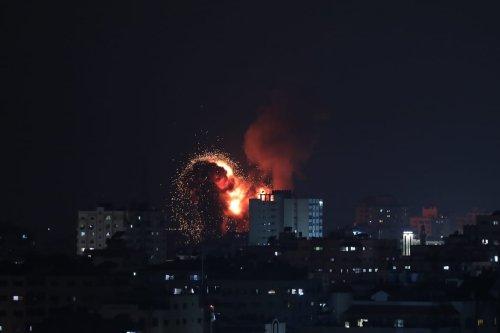 Fire billow from Israeli air strikes in Gaza City, Gaza on May 10, 2021 [Mustafa Hassona/Anadolu Agency]
