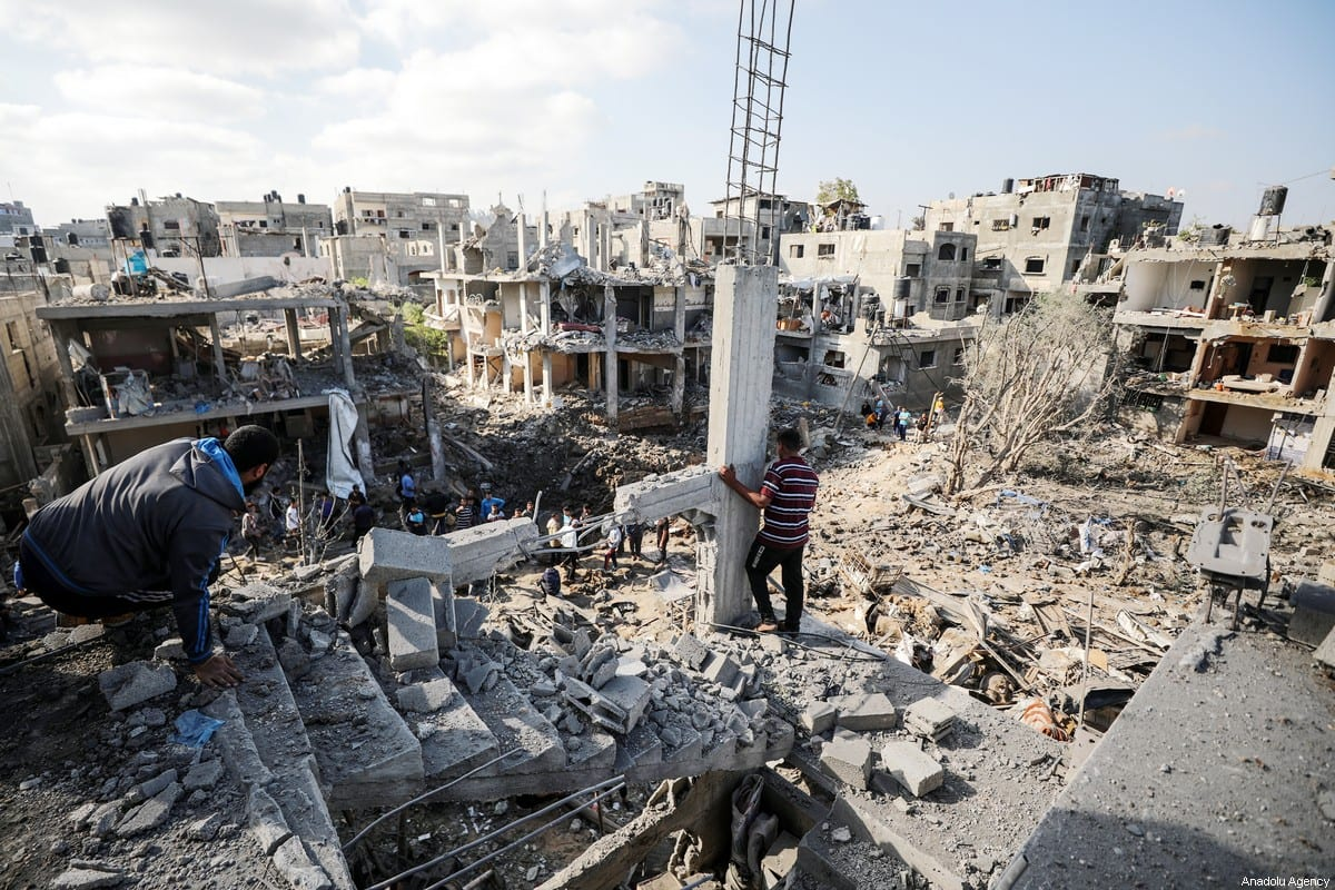 Palestinians search for survivors in the rubble of buildings destroyed by ongoing Israeli airstrikes on Gaza, in Beit Hanoun, Gaza on May 14, 2021 [Ali Jadallah / Anadolu Agency]