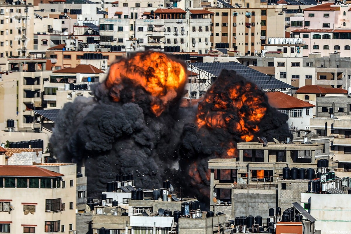 Smoke and flame rise after an attack over a building carried out by Israeli army, in Gaza City, Gaza on May 14, 2021 [Ali Jadallah / Anadolu Agency]