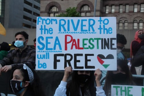 People gather to stage a demonstration in support of Palestinians and to protest against Israeli attacks on Gaza Strip and East Jerusalem on the 73rd Nakba Day at Nathan Phillips Square in Toronto, Canada on May 15, 2021 [Seyit Aydoğan/Anadolu Agency]