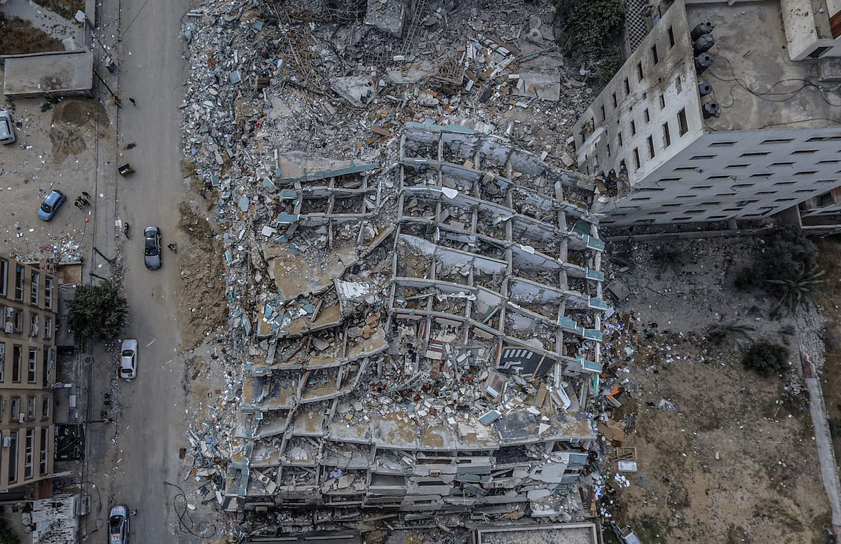 A drone photo shows an aerial view of destroyed 13-storey Cela building that housed international media offices in Gaza City aftermath of 11 days of Israeli airstrikes on the Gaza Strip, on 23 May 2021. [Ali Jadallah - Anadolu Agency]