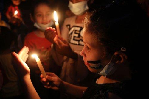 GAZA CITY, GAZA - MAY 23: Palestinian kids light candles in memory of Abu Hattab family killed in the Israel attacks on Gaza, on May 23, 2021 in Gaza City, Gaza. ( Ashraf Amra - Anadolu Agency )