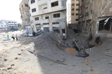 Israeli occupation warplanes targeted residential buildings in Gaza last night, leaving Palestinians homeless [Mohammed Asad/Middle East Monitor]