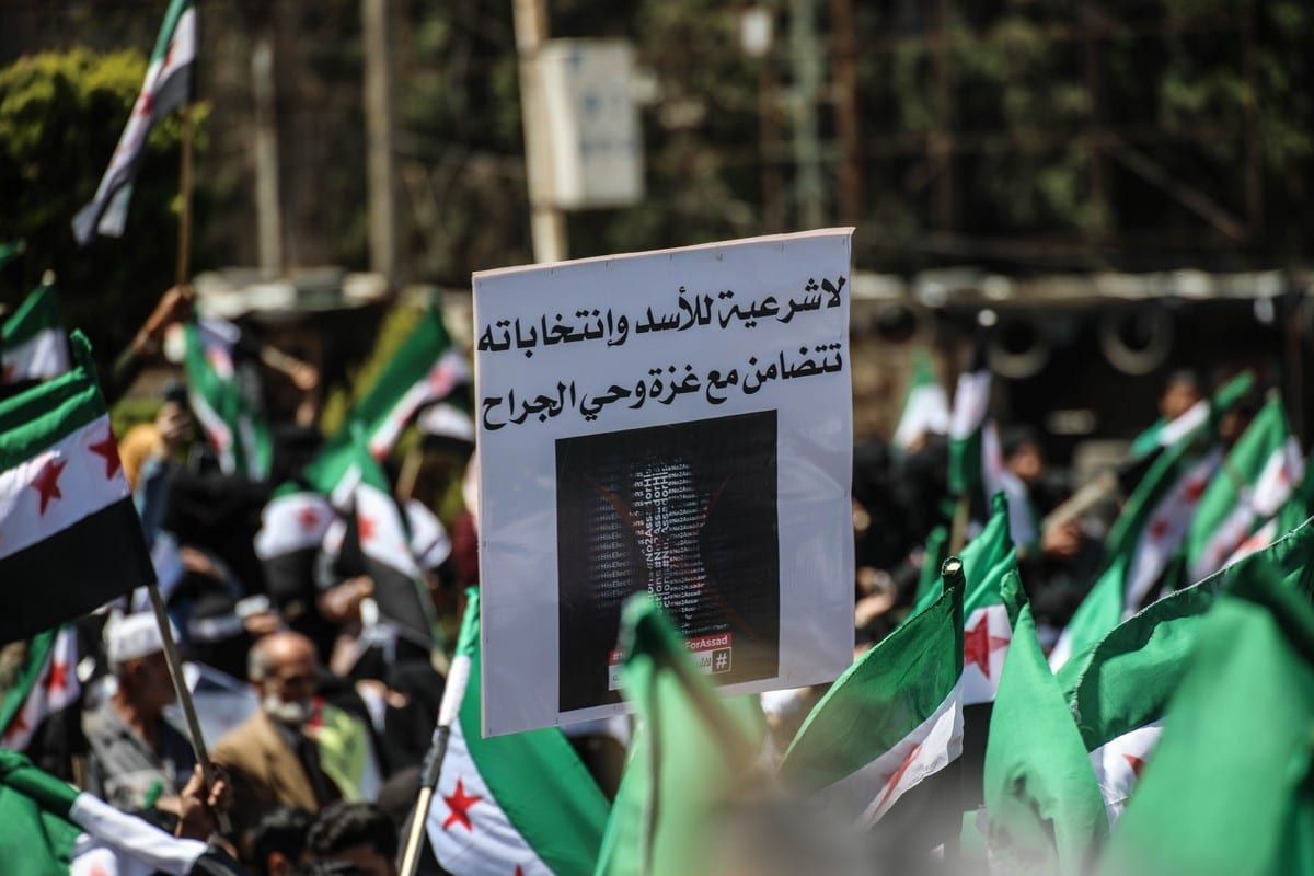 Syrians demonstrate in the city of Idlib against the presidential elections that began today in the areas controlled by the Assad Regime in Idlib, Syria on 26 May 2021. [Izzeddin Idilbi - Anadolu Agency]