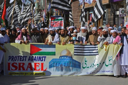 Demonstrators in Pakistan protest against Israel's attacks on Gaza on 21 May 2021 [BANARAS KHAN/AFP/Getty Images]