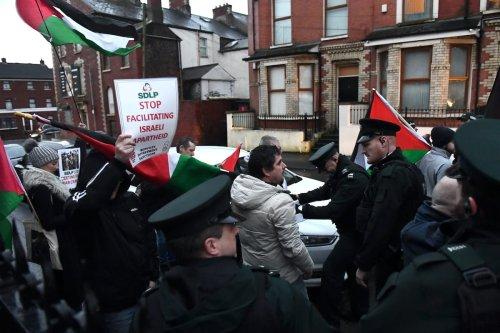 People waving Palestine flags protest in Belfast on February 5, 2019 in Belfast, Northern Ireland [Clodagh Kilcoyne - WPA Pool/Getty Images]