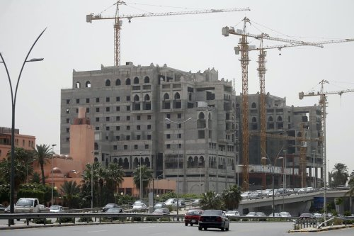 A picture taken on April 22, 2019 shows a hotel under construction in downtown Tripoli, Libya. [MAHMUD TURKIA/AFP via Getty Images)]