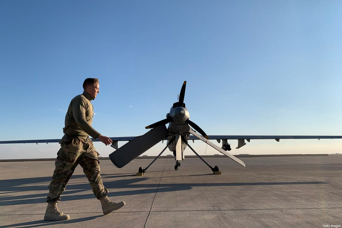 A picture taken on January 13, 2020 shows a member of the US forces walking past a drone [AYMAN HENNA/AFP via Getty Images]