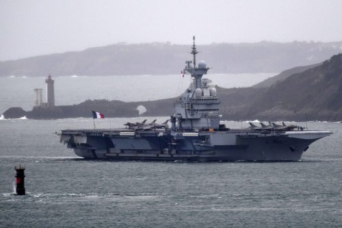 A picture taken on March 13, 2020, shows the French aircraft carrier Charles de Gaulle [FRED TANNEAU/AFP via Getty Images]