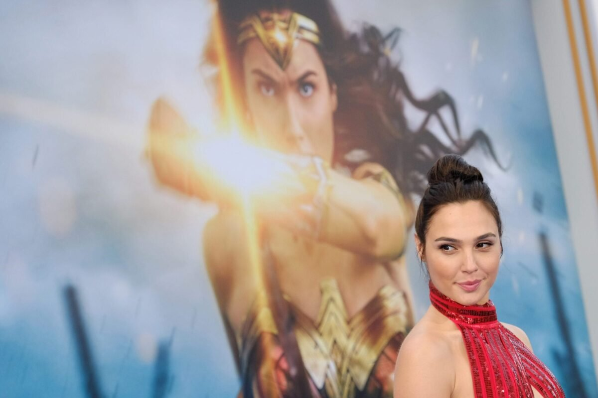 """This photo taken on May 25, 2017 shows actress Gal Gadot at the world premiere of """"Wonder Woman"""" at the Pantages in Hollywood, California. - The much-delayed Warner Bros. superhero sequel """"Wonder Woman 1984"""" will premiere on HBO Max and in theaters simultaneously from Christmas Day in the United States, the studio announced November 18. (Photo by Chris DELMAS / AFP) (Photo by CHRIS DELMAS/AFP via Getty Images)"""
