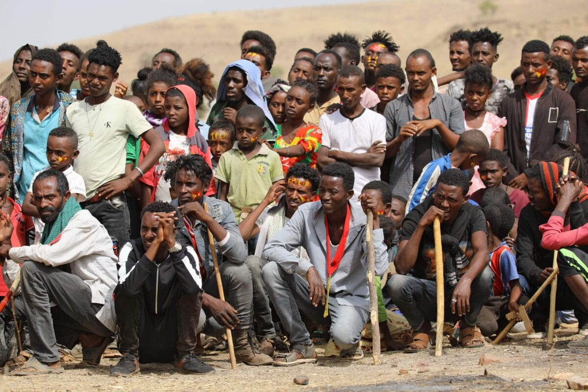 Ethiopian refugees gather to celebrate the 46th anniversary of the Tigray People's Liberation Front at Um Raquba refugee camp in Gedaref, eastern Sudan, on February 19, 2021 [HUSSEIN ERY/AFP via Getty Images]