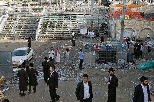Orthodox Jewish men gather early on April 30, 2021 in the northern Israeli town of Meron at the scene of a stampede which took place overnight during a religious gathering near the reputed tomb of Rabbi Shimon Bar Yochai [JACK GUEZ/AFP via Getty Images]